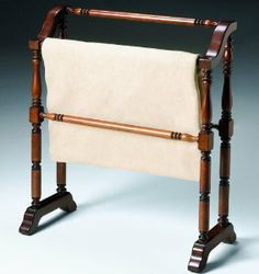 Butler Classic Plantation Cherry Quilt Rack by Butler Specialty Co. $169.00. Horizontal rods for hanging quilts, comforters, bed spreads, duvets, and blankets. Selected solid woods. Can also be used for hanging guest towels. 28 in. W x 12 1/2 in.D x 33 in. H. About Butler SpecialtyButler Specialty Company has been designing and manufacturing high-quality occasional and accent furniture since 1930. Each piece reflects Butler's dedication to enduring design, exquisite craft...