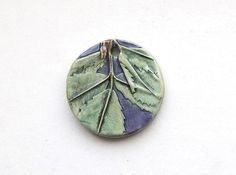 Handmade Ceramic Pendant Alfalfa Leaf with Purple background