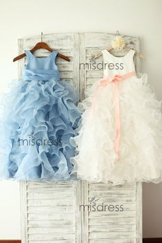 The dress is made of high quality satin/organza Fabric    I love the super puffy organza skirt which creates the ball look for your cutie pie
