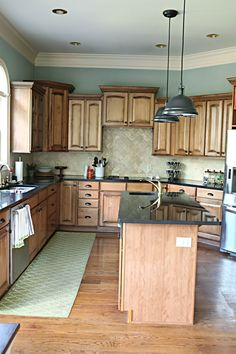 aqua with brown cabinets- like the runner in front of the sink instead of just a small rug