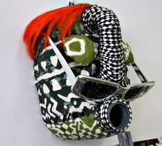 Shop our collection of beautiful textile African masks, handmade from upcycled containers and embellished with an assortment of local fabrics and other media by local artisans in Hout Bay, South Africa. African Masks, Artisan, Banana, Textiles, Concept, Beautiful, Collection, Masks, Flasks