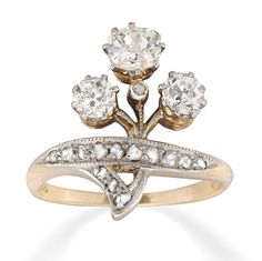 A Late Victorian diamond trefoil cocktail ring, the three old brilliant-cut diamonds weighing an estimated total of 0.8 carats with rose-cut diamond-set stalk and band, all set in silver to a 14 carat yellow gold mount, circa 1900. Gross weight 3.7 grams