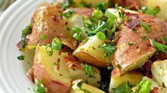 Grilled potato salad with bacon, green onion, and parsley is an easy, mayo-free way to prepare potato salad in the summer.