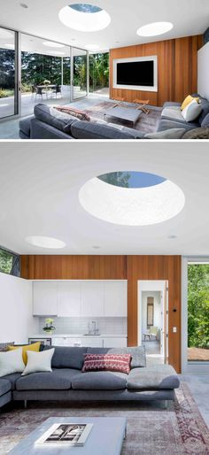 In this small guesthouse, an L-shaped couch provides plenty of seating and acts as a sort of divider between the living space and the small kitchen. The kitchen, with white cabinets and white tile backsplash is simple and modern in its design.