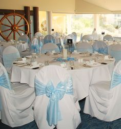 Blue and white color theme - bows on chairs are an elegant touch