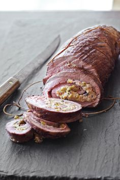 """Roasted Flank Steak Stuffed with Olives and Pecorino - """"This hybrid of the classic Argentinian matambre with the Italian braciole has won us over. I Love Food, Good Food, Yummy Food, Carne Asada, Beef Dishes, Food Dishes, Meat Recipes, Cooking Recipes, Flank Steak"""