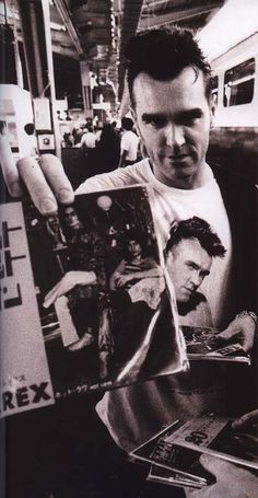 morrissey : holding out a photo of marc bolan of t. rex : [photographer unknown]