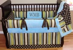 Wesley Stripes N Dots Crib Set  This custom bedding set includes the bumper, blanket and tailored crib skirt. The bumper features the green chocolate and aqua/blue stripes, dots, and ultra soft aqua/blue minky. The blanket is aqua/blue minky backed with a soft cuddle edge and the front coordinates both the fabrics.