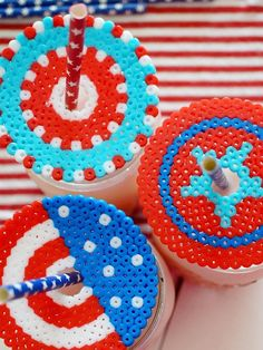 Kids will have fun creating different patterns of Patriotic Fuse Beads Drink Covers for your summer parties. This is a great patriotic craft idea to keep