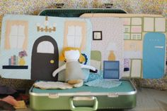 """Vintage Suitcase as Traveling Dollhouse - This compact house has with fabric backdrops that switch the """"rooms"""" up in snap."""