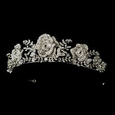 Elegantly described in rhinestones and Swarovski crystals, the arrangement of rose flowers and leaves design brings a noble aura to this tiara headpiece. Bridal Crown, Bridal Tiara, Bridal Headpieces, Silver Rhinestone, Silver Charms, Silver Rings, Wedding Tiaras, Wedding Bride, Wedding Veils