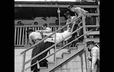 Chavez Ravine evictions - May 8, 1959: Aurora Vargas is carried by LA County Sheriff's deputies after her family refused to leave their house in Chavez Ravine to make way for Dodger Stadium. (photo by Los Angeles Mirror-News photographer Hugh Arnott)