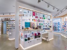 """The materials have been selected to give the impression of being in a """"modern - warm- natural & professional"""" pharmacy. Dibon brushed it is used at the storefront and for the medicaments wall to give a modern and futuristic image for the brand."""