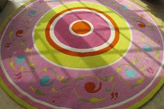 beautiful colorful circle rug! hot pink, lime green, orange, light pink, acid green,and bright blue designs! LoLo Moore Design