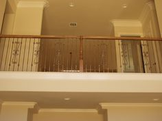 This staircase design was created using Twist series balusters. The long single twist baluster (16.1.21) and the spiraled heart scroll baluster (16.1.41) are paired to create a uniquely designed staircase. These components are available in a Satin Black (shown), Copper Vein, Oil Rubbed Bronze, and Oil Rubbed Copper powder-coated finish. We offer parts, install services, and custom components throughout Texas. Click the image for more information.