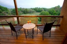 Idyllic View of African Bushveld from a Patio with Table and Chairs and Two Cocktails. Private Games, Outdoor Tables, Outdoor Decor, Backyard, Patio, Game Reserve, Travel Companies, Stock Pictures, Table And Chairs