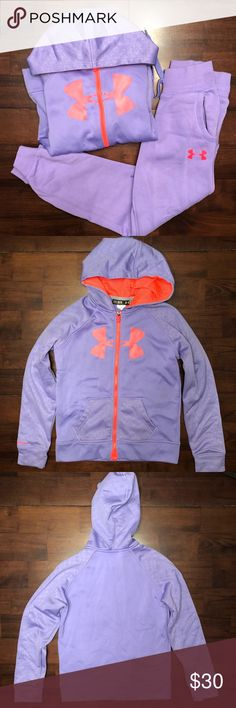 Under Armour Girls Sweatshirt Hoodie & Sweatpants Gently worn!! No holes or stains on the Hoodie but a small pick on the hood as pictured. The pants have no holes but a few light stains on the leg as pictured. Both are medium. Under Armour Matching Sets