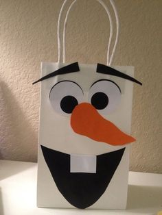 2014 Christmas Frozen Olaf candy bag with exaggerated eyebrows for kids #2014 #Christmas #Frozen #Olaf #ornament