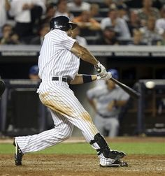 GAME 89: Monday, July 16, 2012 - New York Yankees' Raul Ibanez hits a grand slam during the eighth inning of the baseball game against the Toronto Blue Jays at Yankee Stadium in New York. (AP Photo/Seth Wenig).