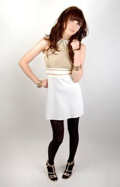 Gold mini dress (maybe not the black tights)