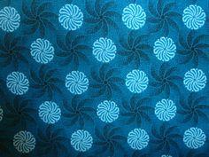 Turquoise Shweshwe. Worldwide shipping available from http://www.meerkatshweshwe.com/