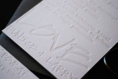 simple. timeless. classic wedding invite blind emboss  richie designs