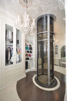 Wood Dressing Room with Pneumatic Vacuum Elevator traditional-closet