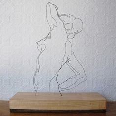 Very cool wire sculpture of a figure drawing