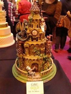 castle cake with added dragon, knight and princess