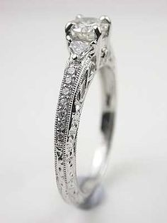 i want simple, small and low profile please  Diamond Filigree Engagement Ring