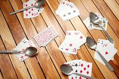 Spoons~~I played this one time in GA with my cousins and almost peed myself laughing b/c we had so much fun! I haven't played it since b/c I didn't remember how!