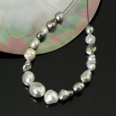 Eastern Trade Winds :: Genuine Pearls :: Tahitian Black South Sea Pearls :: Tahitian Black Pearl Strands :: TAHITIAN SOUTH SEA PEARLS 16 Multicolor loose fully-drilled Baroque 10.0 g / 5.70""