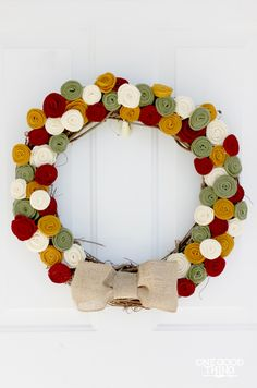 The leaves are starting to change here in the mountains, so why not celebrate with a DIY fall wreath for your front door? This wreath is simple to make, and will look lovely on your front door all season long. :-)