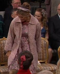 Princess Madeline of Sweden display the growing baby bump in her Valentino dress, attend the christening of her nephew Prince Gabriel of Sweden at Drottningholm Palace Chapel on December 1, 2017 in Stockholm, Sweden.