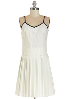 So Fresh and Pristine Dress. With champagne, strings of gleaming lantern lights, and your pristine white frock, this backyard gathering is not your average picnic. #white #modcloth