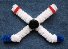 Good idea for young hockey fans! But it would look better with green, black and gold pipe cleaners.   http://crafts.kaboose.com/crossed-hockey-sticks.html