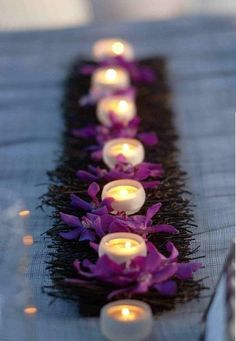 twigs and orchids with candles for a beautiful Diwali tablescape - loved & pinned by www.omved.com