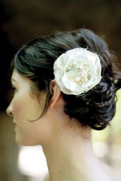 Wedding Hair Styles; braided up-to with a flower pin