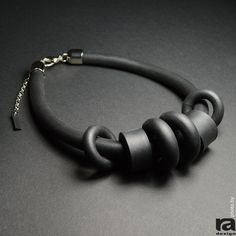 Internal volume - 44 cm to 52 cm / 17.32 inch to 20.47 inch Thickness of rubber - 1,2 cm / 0,47 inch Compositions - Foam rubber and metal alloys RA ZEN line of jewelry is defined by its simple lines and specific material. Black foam rubber makes it soft, flexible and resilient, as well as easy to wear, due to its extremely light weight. Maintenance instructions: - Gently wipe with a wet sponge and apply cream (vaseline or oil) - Dont soak in water - Dont stretch too hard - Love yo...