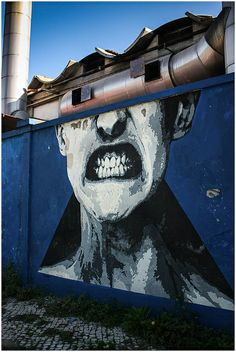 "by EIME - Wall from Project ""Rostros do Muro Azul"" - Psychiatric Hospital ""Julio de Matos"", Lisboa"