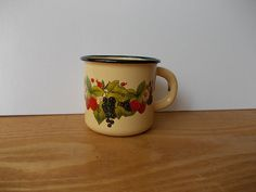 This small yellow enamel mug with berries print comes from Soviet USSR.    Very good condition, unused.    Measurements: Diameter - 3  Height - 3 You