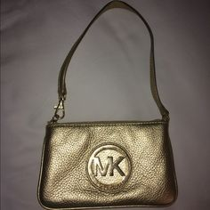 Gold Michael Kors Wristlet This Michael Kors Gold wristlet is absolutely adorable. It is in great condition other than a few scratches on the the Michael Kors Emblem. MICHAEL Michael Kors Bags Clutches & Wristlets