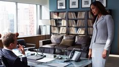 (l-r) Gabriel Macht as Harvey Specter, Gina Torres as Jessica Pearson -- (Photo by: Shane Mahood/USA Network)