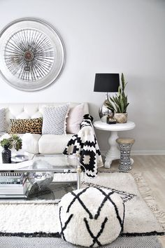 modern eclectic living room with neutral decor and black and white accents.