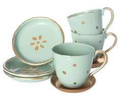 Maileg Enamel Mini Tea Set: A beautifully presented gift box designed in duck egg blue with traditional gold pattern and shimmery gold ribbon houses a gorgeous min enamel tea set in duck egg blue with gold spots and rims, making a very pretty addition to any Maileg collection.  The tea set includes 3 miniature cups with gold saucers and three tea plates in duck egg with gold spots and rim.  Suitable for play with mini and medium rabbits, bunnies, best friends cat, dog or rabbit.