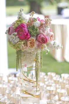 coral-peony-centerpiece | coral-and-peach-centerpiece | coral-and-gold-centerpiece | mint-julep-station | outdoor-wedding-beverages  Read More: http://www.stylemepretty.com/little-black-book-blog/2014/04/08/charming-outdoor-southern-wedding/