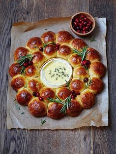 A gorgeous centerpiece! Baked camembert with a brioche wreath. Can use Brie too!