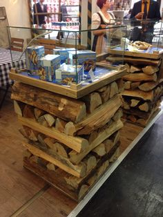 Anuga- trade show display table  not crazy about the top acrylic case but love the stacked wood