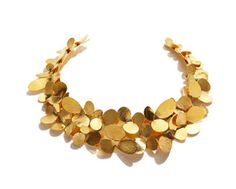 All of the work by this company really reminds me of Merry Renks work.    Herve-Van-Der-Straeten-Gold-Petal-Collar-Necklace.jpg
