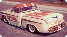 """KOPPER KART""  Started out as a 1956 Chevy partly customized with a 5 ½ inch chop top. Then the top panel was covered with pleated rust and white naugahyde. The body was sectioned 4 inches throughout upper panel with a hand formed pancake hood. Front and rear panels had been molded and sculptured with full cavities and grill inserts mounted in rubber to absorb shock. Quad headlights and bottom directional signal are shaded and frenched in.  Center grill has electronic eye to control head…"